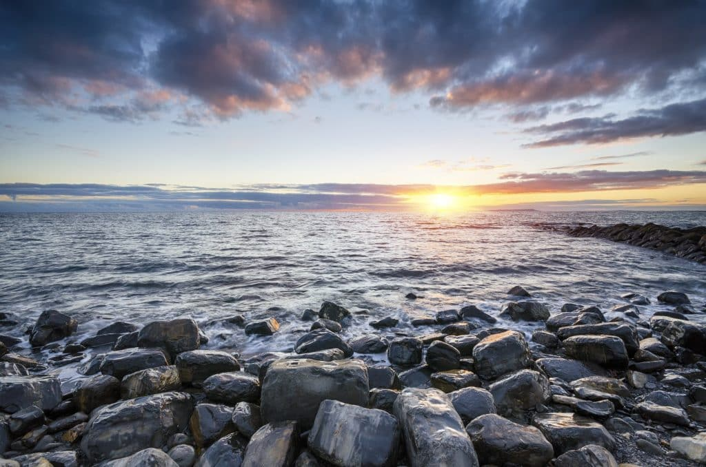Sea glass turns what used to be garbage and turns it into polished pieces to be used in crafts. Learn how to get started with sea glass hunting today! (Sunset at Kimmeridge Beach)