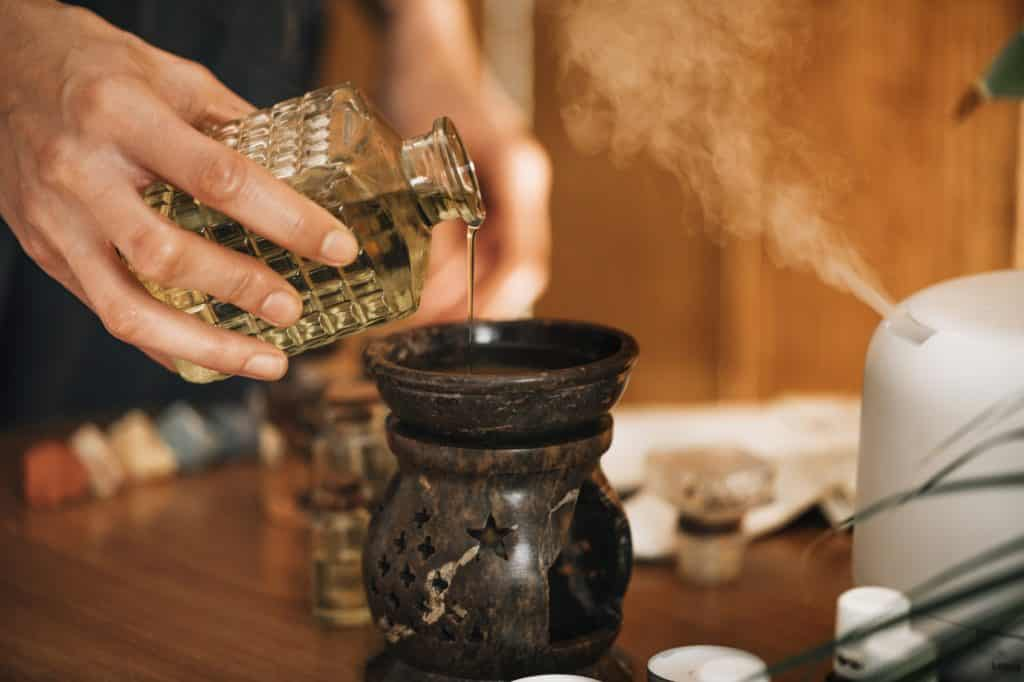 Ayurveda Aromatherapy Massage, Pouring Aromatic Oil in Essential Oil Diffuser