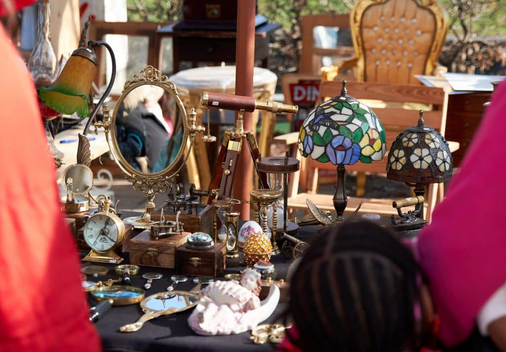 Vintage items for sale at a stall on street flea market.
