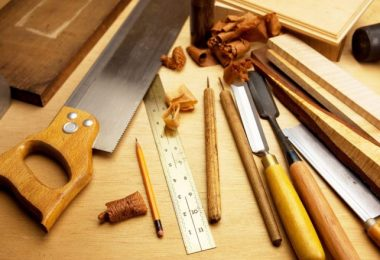 woodworking tools placed on wooden surface